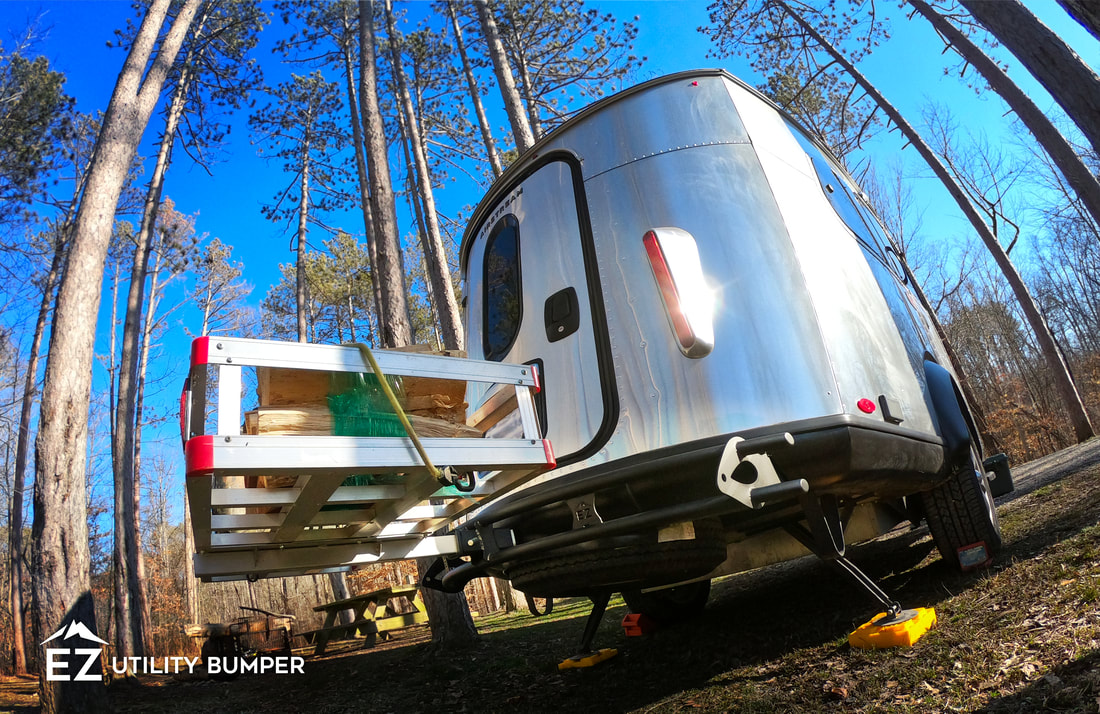 Airstream Basecamp with the EZ Utility Bumper carrying a cargo basket attachment.